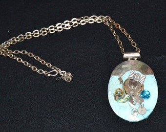 Necklace, Unique,Original Large Turqoise Pendant, with Sterling Trim, decorated, front & back, with variety of clock and stone pieces.