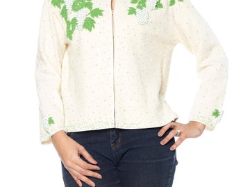 Cream Colored Sweater With Green And White Floral Beading Size: 6