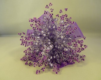 Bridesmaids bouquet in Lillac and purple with purple ribbon. Flower girl bouquet in lavender and purple. Wedding bouquet. Purple wedding