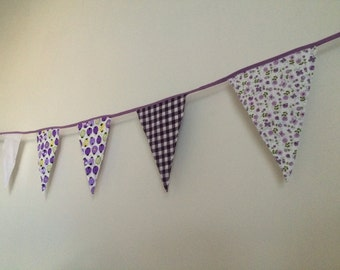 Purple with white flag line with ladybugs and flowers