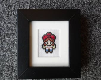 Toy Story Jessie Cross Stitch in black frame and mount
