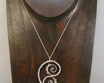 Silver wire wrapped paisley and swirls necklace