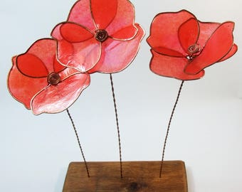 Poppies: A trio of poppies on wood - copper wire, paper and oak