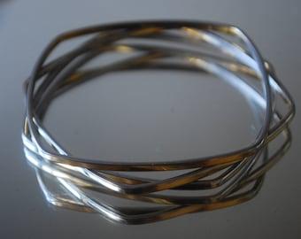 set of three square goldtone bangle bracelets - Trifari - hip to be square - 1960's