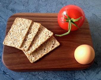 A sleek little american walnut breakfast board