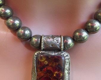 Tibetan  Repousee Amber Colored Pendant