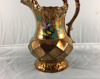 Victorian copper lustre jug with floral enamel decoration 7.5""