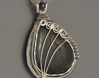 Black found stone wire wrapped pendant