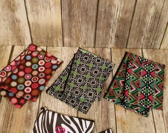 Personalized Cosmetic Bag Set. Available in Zebra, Circles, Swirls, and Aztec. 4.5 in by 6 in and 5 in by 8 in. Initial and Name.