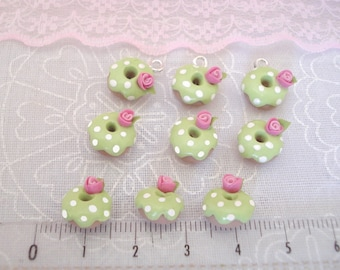 Set of 3 small pistachio DONUTS decorated with a pink sweet