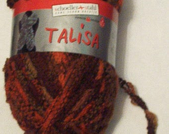 Ball of wool fancy to knit a scarf, orange and Brown Afghan