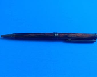 Hand turned cocobolo  twist style trimline pen in gun metal finish