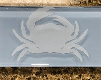 Glass subway tile with etched crab