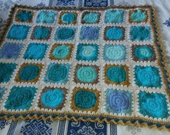 Crocheted baby blanket, cheerful blocks