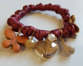 Knotted bracelet with charms