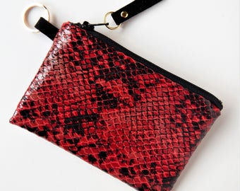 Red leather card case with RFID blocking lining.