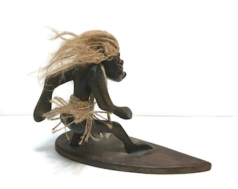 Vintage hand carved tribal surfer figure on surfboard, Newport Beach, CA, souvenir, rope hair, shell necklace c1970s
