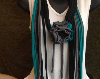 Teal, black, and gray braided tshirt necklace with flower embellishment