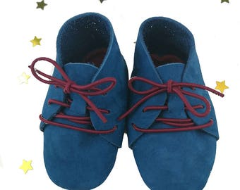 shoe for a newborn baby in petrol Blue Suede and leather