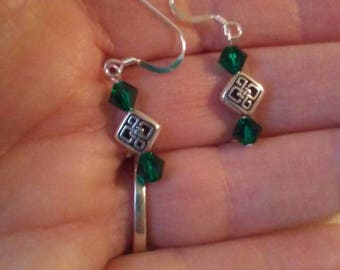 Emerald green and silver pierced earrings with Celtic knot beads.