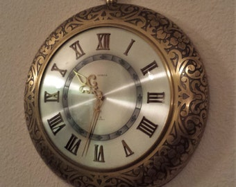 Vintage SEMCA 8-Day Swiss Mid-Century Brass wall clock