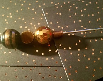 black and gold cigarstick