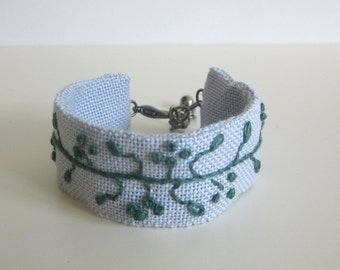 Textile bracelet, grey linen fabric cuff with teal green hand embroidery, hand stitched jewelry, wearable art boho style, fabric jewellery