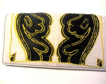 Leather wallet with hand-embroidered motif