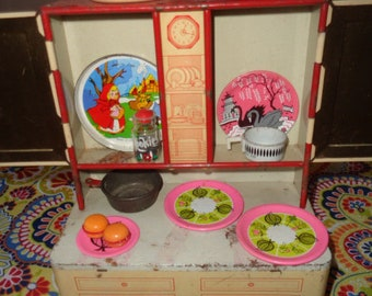 Charming Kitschy Mid Century Retro Wolverine Hoosier cabinet cupboard with tin toy dishes and accessories