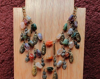 Mexican Milagro necklace with gold and silver colored Milagros, with agate, quartz and amethyst beads