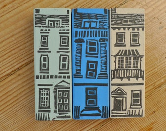 Trio of handprinted little wooden houses