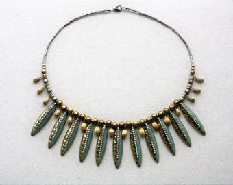 Necklace with bronze and green and bright metal pendants
