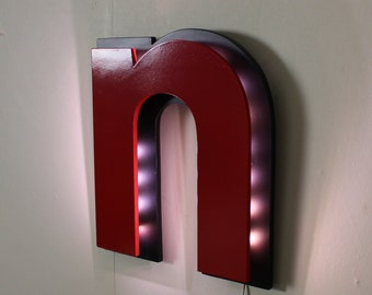 bright letter sign in red and black pilot style