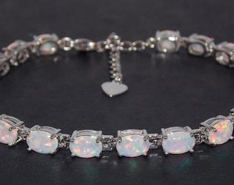 Silver Fire Opal Oval Cut 24.02ct Tennis Bracelet (925)