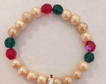 Christmas themed beaded bracelet with Reindeer charm