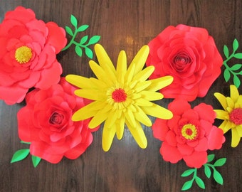 6 red and yellow paper flowers.
