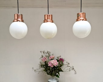 Vintage milk glass balls. copper supports