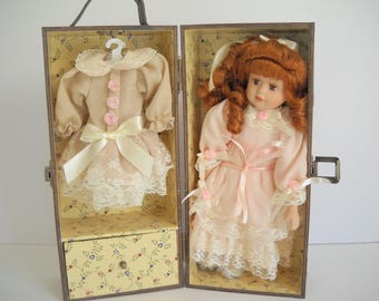 Porcelain Doll with Stand and Wooden Cabinet