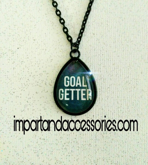 GOAL GETTER~ 18 x 25 mm teardrop glass cabochon inspirational achiever positive vibes only personality sparkles in a black metal setting.