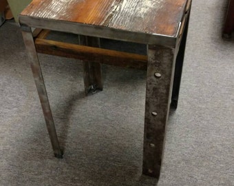 Handsome end table made of reclaimed lumber and steel.