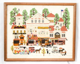 Needlepoint Framed Picture - Antique Downtown Stores Dated 1980 - 1980s Needlework - Old Fashioned Victorian Scene - Charles Wysocki - R2128