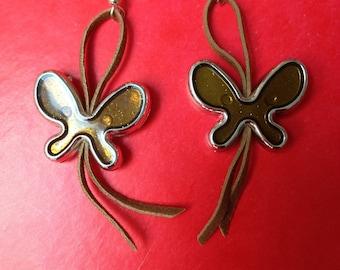 pair of copper on Brown felt butterfly earrings