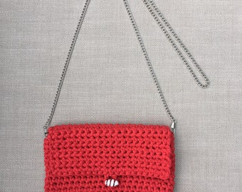 Red handbag with a chain