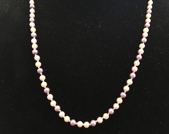 24 inch necklace with hand knotted pink, cream, and purple pearls.