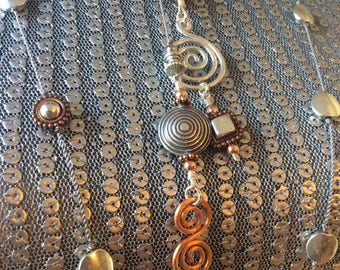 Modern Spirals in sterling and copper