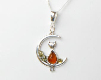 "Baltic Amber Cat on a Moon pendant set in Sterling Silver and suspended from an 18"" Sterling Silver chain."