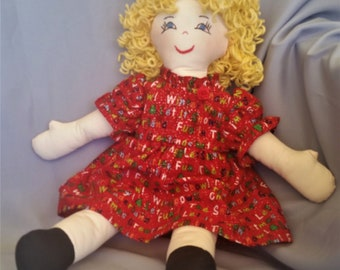 15 inch cloth (rag) doll, with hair and eye color of your choice, comes dressed in a cheerful red holiday dress and white panties