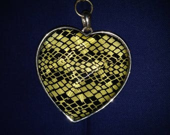 UNIQUE HEART PENDANT - - This is such a cool necklace !!!  The black beaded chain makes it even better !!!  Will miss this one!