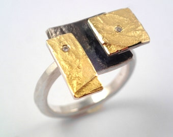 The Rubik's cube. An artistic geometric gold and silver ring with diamonds and hammered band for nights out.
