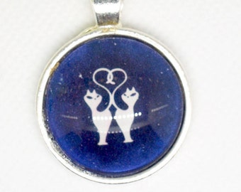 Cats love - colored metal shows silver glass cabochon pendant